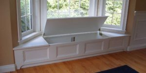Beautifully hidden white window seat with power!