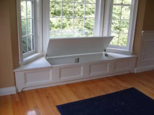 Beautifully hidden white window seat with storage!