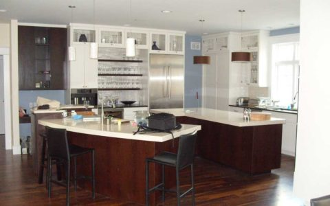 Elegant, dark-finish kitchen remodel by MLG Woodworking
