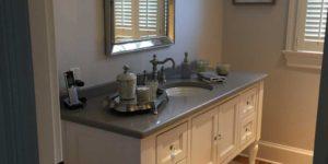 Elegant, Victorian bathroom vanity with marble top by MLG Woodworking